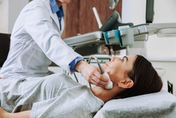 Woman undergoing ultrasound scan in clinic