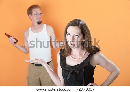 Woman unhappy with man holding beer bottle