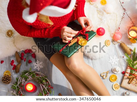 Woman unwrapping Christmas gifts