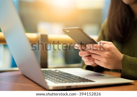 Woman use of cellphone and laptop computer