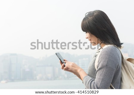 Woman use of mobile phone at outdoor