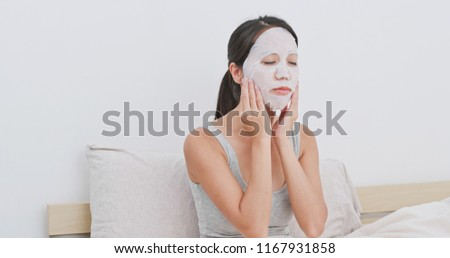 Woman use of paper mask at home