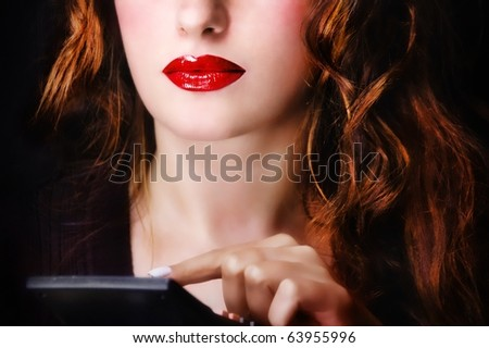 Woman using a calculator