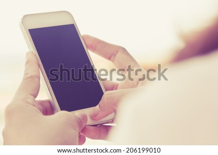 Woman Using a Smart Phone #206199010