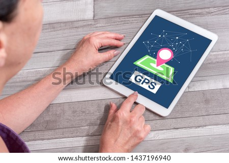 Woman using a tablet showing gps concept #1437196940