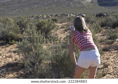 Woman Using Camera Phone on Safari
