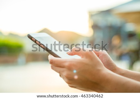 Woman using cellphone #463340462