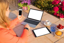Woman using different tech devices