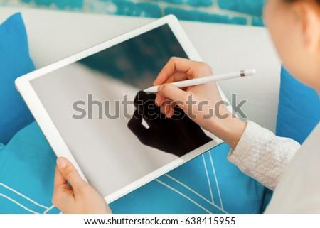 Woman Using Digital Tablet #638415955