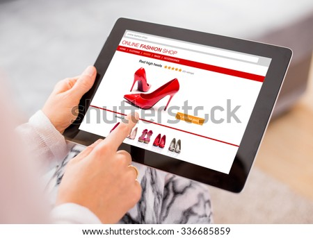 Woman using digital tablet to shop online