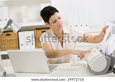 Swell Woman Using Fax Machine At Home Office Stock Photo 24972718 Largest Home Design Picture Inspirations Pitcheantrous
