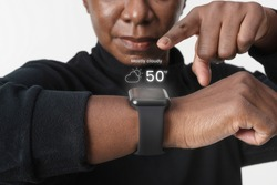 Woman using holography from smartwatch wearable technology