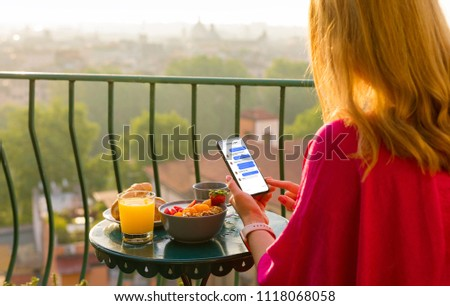 Woman using instant messaging app on phone #1118068058