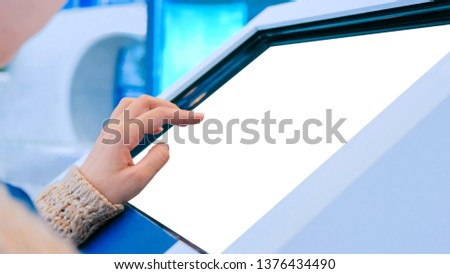 Woman using interactive digital informational kiosk with touchscreen display at urban exhibition - scrolling and touching. Education, mock-up, template and technology concept #1376434490