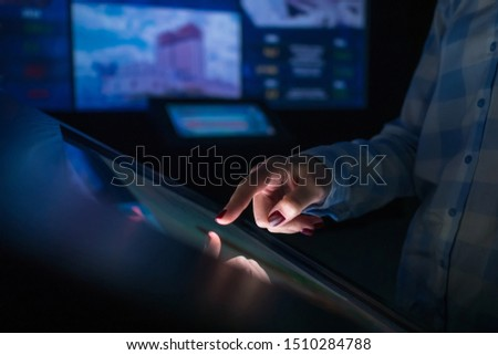 Woman using interactive touchscreen display of electronic multimedia terminal at modern museum or exhibition. Education, futuristic and technology concept #1510284788