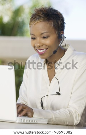 Woman Using Internet Telephone Service