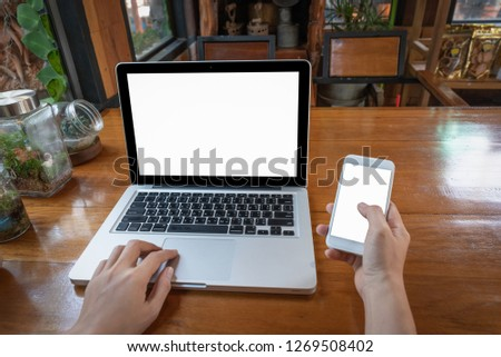 woman using laptop and smartphone in cafe #1269508402