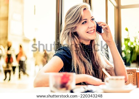 Photo of Woman using mobile phone in a Bar