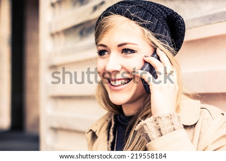 Woman using mobile phone outdoor