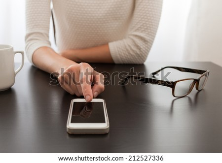 Woman using mobile smart phone
