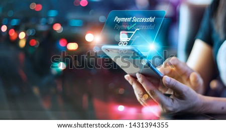 Woman using mobile smart phone, online payment, banking and online shopping in the night light colorful background