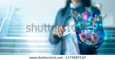 Woman using mobile smartphone with credit card  payments online shopping and icon customer network connection on virtual screen, digital marketing, online banking and business technology.
