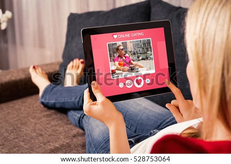 Woman using online dating app on tablet