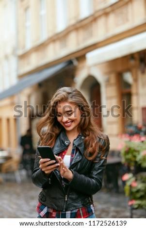 Woman Using Phone On Street  #1172526139