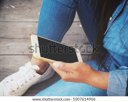 Woman using smart phone #1007614906