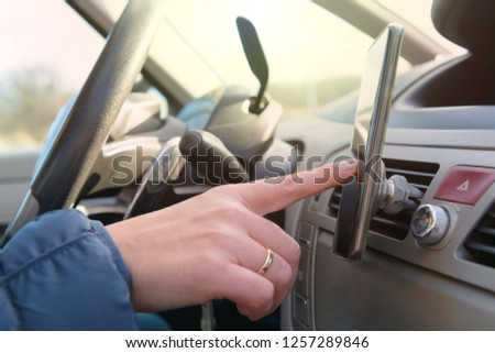 Woman using smart phone as navigation while driving the car. Risky driving behaviors concept