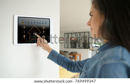 Woman using smart wall home control system