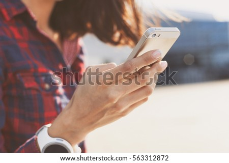 woman using smartphone in the...