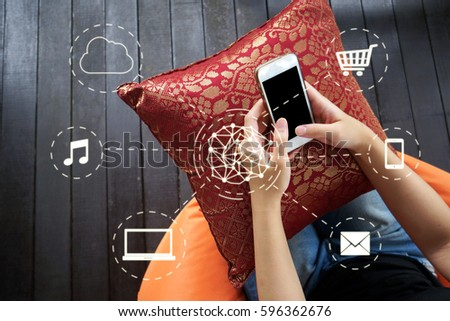 Woman using smartphone with network connection interface