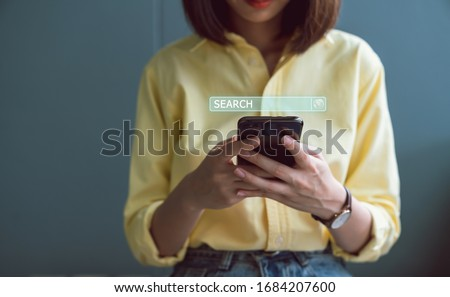 Woman using smartphones and searching browsing Internet button on virtual on screen mobile.