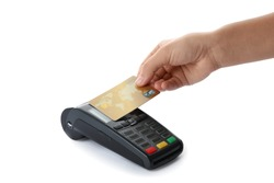 Woman using terminal for contactless payment with credit card on white background