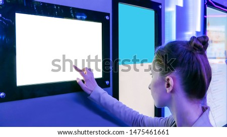 Woman using white empty interactive touchscreen display at modern technology exhibition - close up shot. Mock-up, template, scifi, education, future and technology concept #1475461661