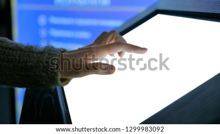 Woman using white empty interactive touchscreen display at modern technology sci-fi exhibition - close up shot. Mockup, template, scifi, education, future and technology concept #1299983092