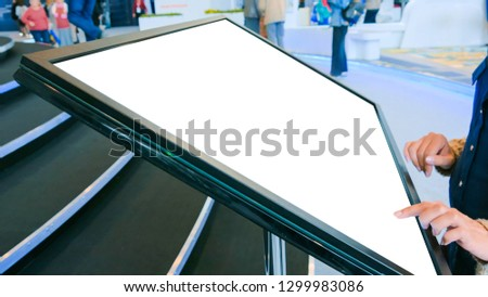 Woman using white empty interactive touchscreen display at modern technology sci-fiexhibition - close up shot. Mock up, template, scifi, education, future and technology concept #1299983086