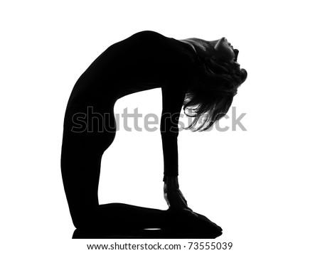 woman ustrasana camel pose yoga posture position in silouhette on studio white background full length
