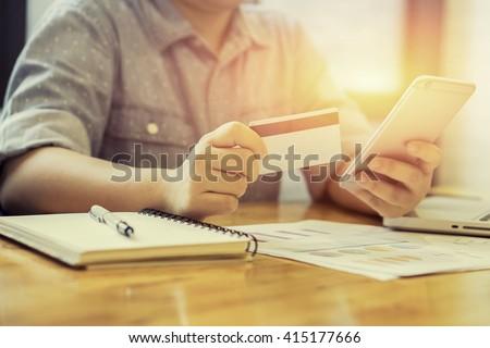 woman verifies credit card...