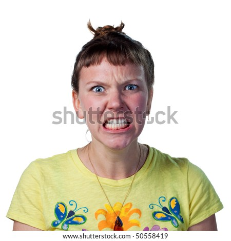 Woman very angry and upset, speaking through gritted teeth
