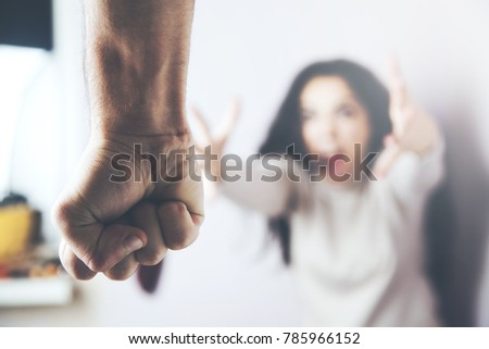 woman victim of domestic...