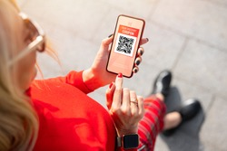 Woman viewing discount coupon on mobile phone