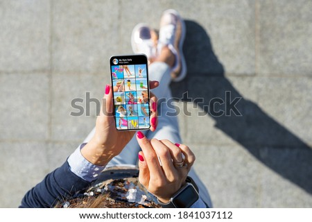 Woman viewing photo gallery posted on social media