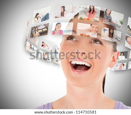 Stock Photo Woman viewing pictures around her head and smiling on grey background