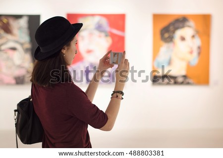 Woman Visiting Art Gallery Lifestyle Concept #488803381