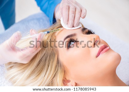 Woman visiting doctor for plastic surgery