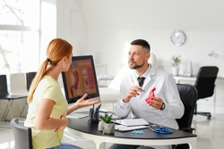 Woman visiting gastroenterologist in clinic