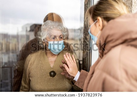 Woman visiting her grandmother in isolation during a coronavirus pandemic  Photo stock ©