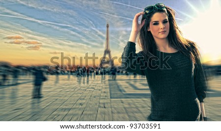 Woman visiting Paris in France at the Trocadero square  with the Eiffel tower on the background - stock photo